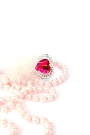 Red valentine heart,feather,pink pearls on white background. photo