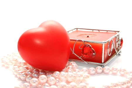Valentine heart,candle,,pink pearls on white background. photo