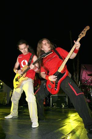 headbang: LIMASSOL,CYPRUS-JUNE 7:Bassist Alexey Kolyukhov and guitarist Roman Valeryev of Russian heavy metal band Kolizey plays in Cypriot-Russian festival June 7, 2008 in Limassol,Cyprus.