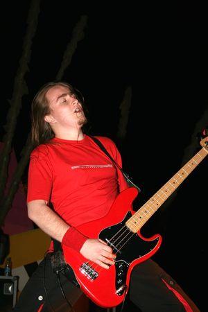 headbang: LIMASSOL,CYPRUS-JUNE 7:Bassist Alexey Kolyukhov of Russian heavy metal band Kolizey plays in Cypriot-Russian festival June 7, 2008 in Limassol,Cyprus.