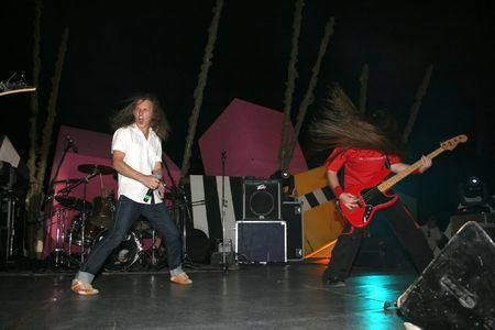 headbang: LIMASSOL,CYPRUS-JUNE 7:Bassist Alexey Kolyukhov and vocalist Yevgeniy Yegorov of Russian heavy metal band Kolizey plays in Cypriot-Russian festival June 7, 2008 in Limassol,Cyprus.