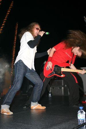 headbang: LIMASSOL,CYPRUS-JUNE 7:Bassist Alexey Kolyukhov and vocalist Yevgeniy Yegorov of Russian heavy metal band Kolizey plays in Cypriot-Russian festival June 8, 2008 in Limassol,Cyprus. Editorial