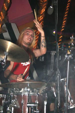 headbang: LIMASSOL,CYPRUS-JUNE 7:Drummer Vasiliy Gorshkov of Russian heavy metal band Kolizey plays in Cypriot-Russian festival June 7, 2008 in Limassol,Cyprus.