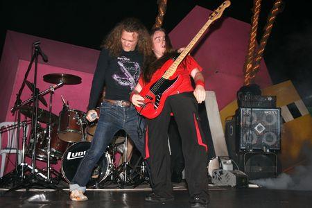 vocalist: LIMASSOL,CYPRUS-JUNE 7:Bassist Alexey Kolyukhov and vocalist Yevgeniy Yegorov of Russian heavy metal band Kolizey plays in Cypriot-Russian festival June 8, 2008 in Limassol,Cyprus. Editorial