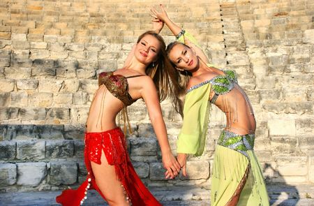 danseuse orientale: Beautiful belly  dancers on the ancient stairs of  Kourion amphitheatre in Cyprus.
