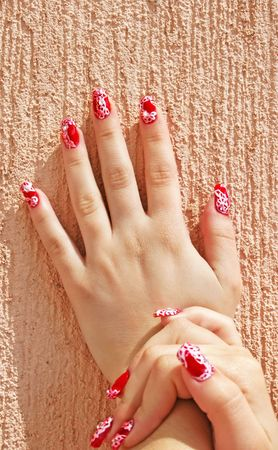 Hand with nail art isolated on wall background. photo