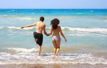 Couple walking to the sea. photo