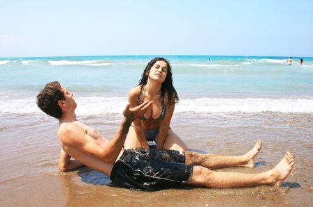 Teens having fun on the beach. photo