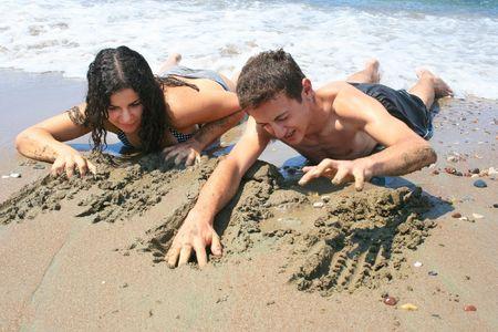 Teens creeping from the sea. photo