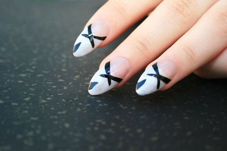 Woman nail art fingers isolated on spotted background. Stock Photo