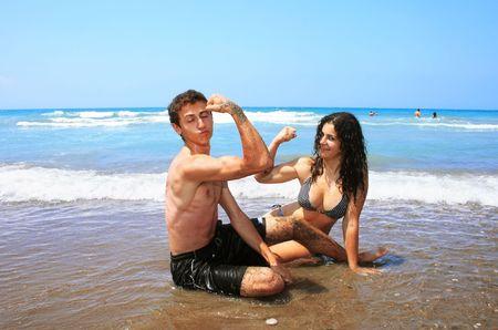 Teens on the beach,having fun. photo