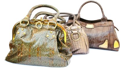 vanity bag: Three woman bags isolated on white background. Stock Photo