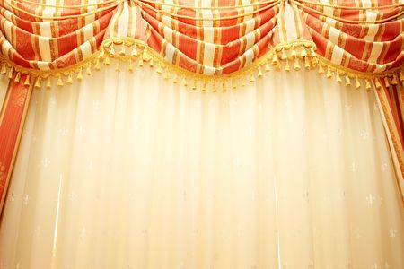 Luxurious red and yellow  curtains as a background. Фото со стока