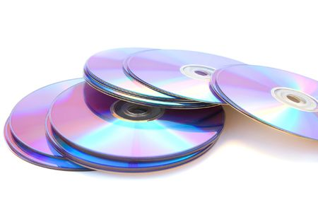 Many printable dvds isolated on white. photo