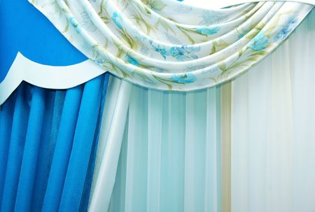 Blue luxurious curtains as a background.