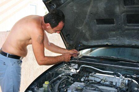 Man repairing old car.