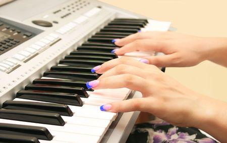 Woman playing professional keyboard. photo