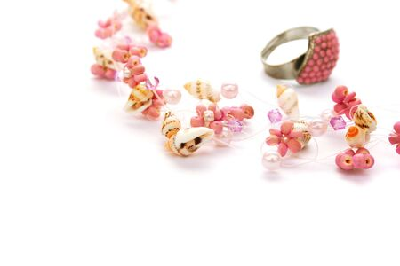 perls: Necklace and ring isolated on white background. Stock Photo