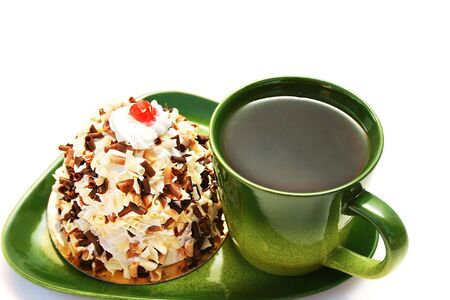 Cup of tea and cake isolated on white background. photo
