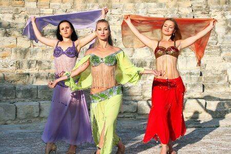 Beautiful belly dancers  on the ancient stairs of Kourion amphitheatre in Cyprus. photo