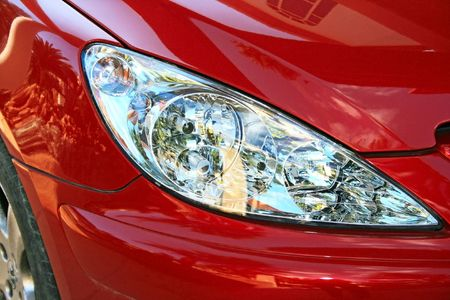 Red car luxurious headlights. Stock Photo - 7261682