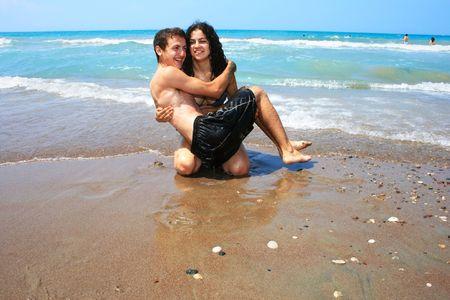 Teens havind fun on the beach. photo