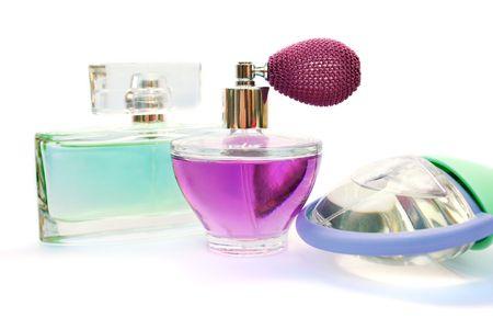 Three perfume bottles isolated on white background. photo