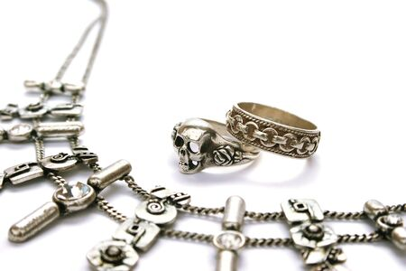 Ancient style necklace and rings isolated on white background. photo