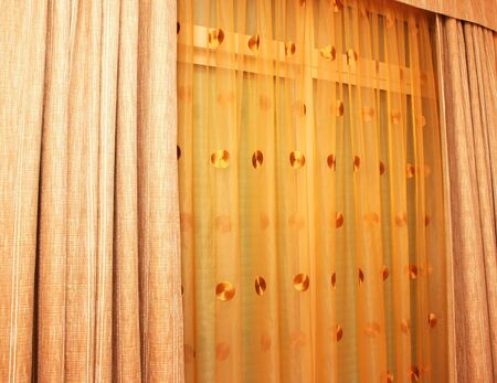 Brown and golden curtains as a background. photo