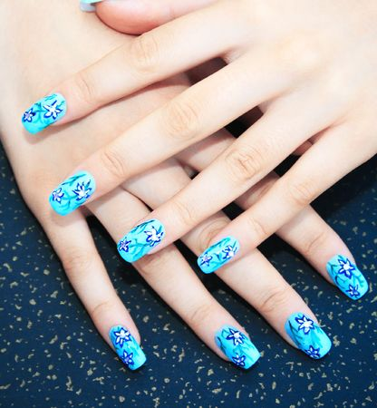 nail art: Hands with nail art on spotted background.