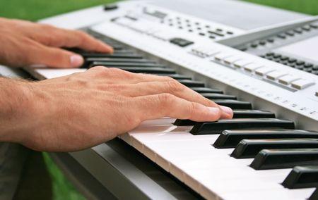 Musician playing on keyboard. photo