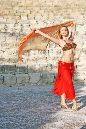 Beautiful belly  dancer on the ancient stairs of  Kurion amphitheatre in Cyprus. photo