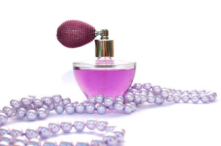 Perfume and necklace isolated on white background. photo