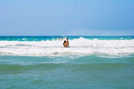 People having fun on sea waves. photo