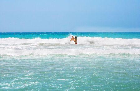 Couple on the sea waves. photo