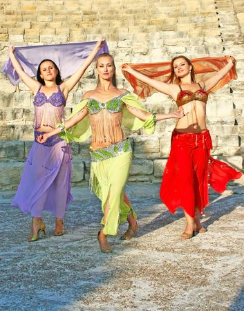 amphitheatre: Beautiful belly dancers on the ancient stairs of Kourion amphitheatre in Cyprus. Stock Photo