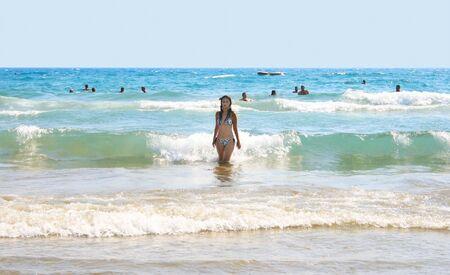 Pretty brunette girl in sea. photo