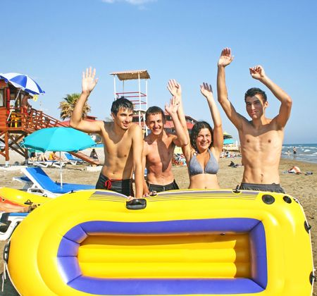 young people with boat on the beach.