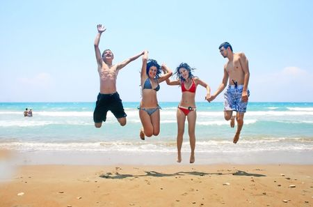Teens jumping at the sea. photo