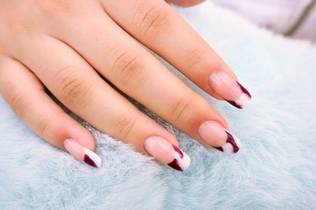 Woman hand with nail art onblue fur  background. photo