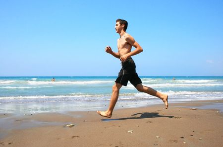 Running boy on the beach. photo