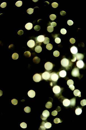 Sparkling spots on black background. Stock Photo - 7823526