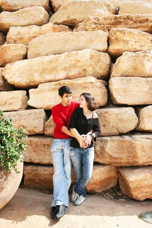 Couple at the vintage wall. photo
