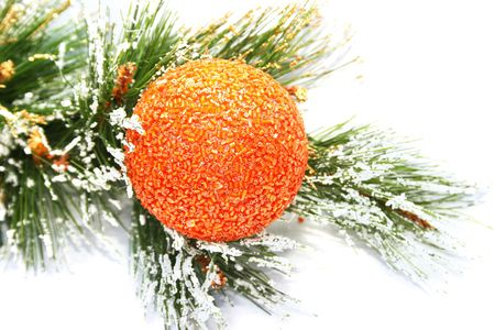 Christmas orange  ball and fir tree on white background. Фото со стока