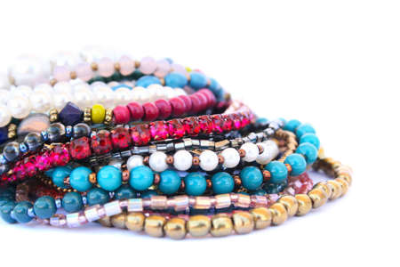 Colorful bracelets and necklaces isolated on white background. photo