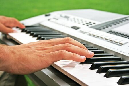 Musician playing on keyboards. photo