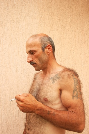 hairy chest: Smoking man vertical picture. Stock Photo
