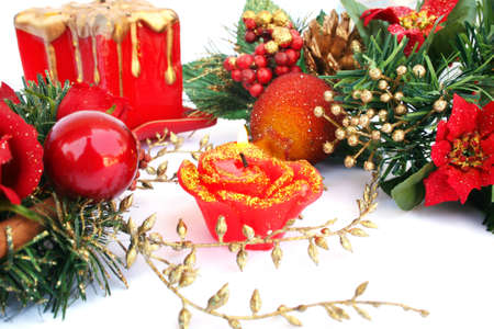 Christmas decorations and  candle  isolated  on white background. photo