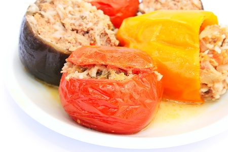 Stuffed vegetables in plate isolated on white background. photo