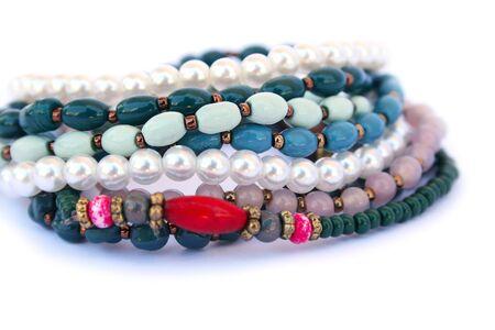 Bracelets and necklaces isolated on white background. photo